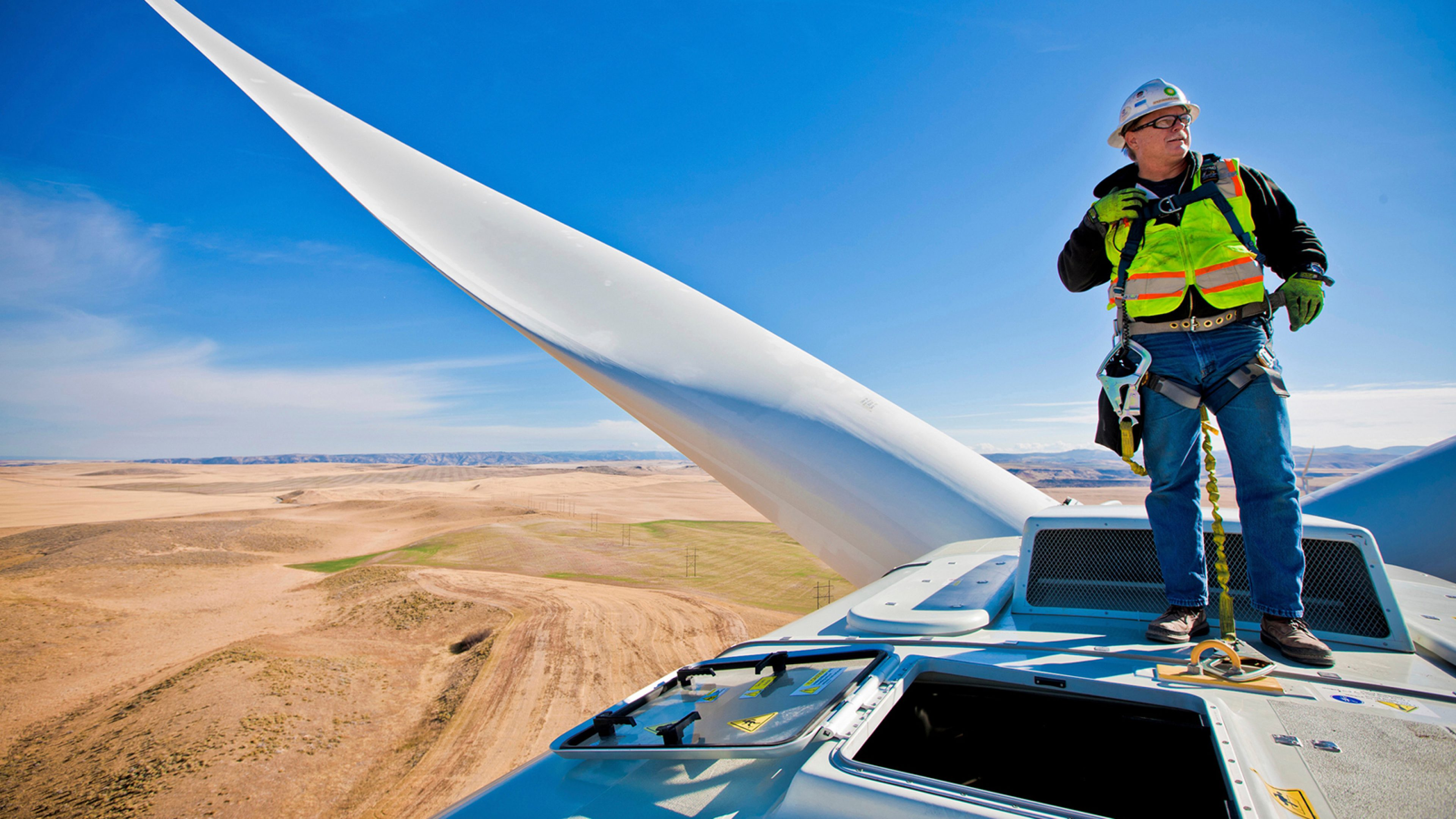 Engineer stood on a turbine