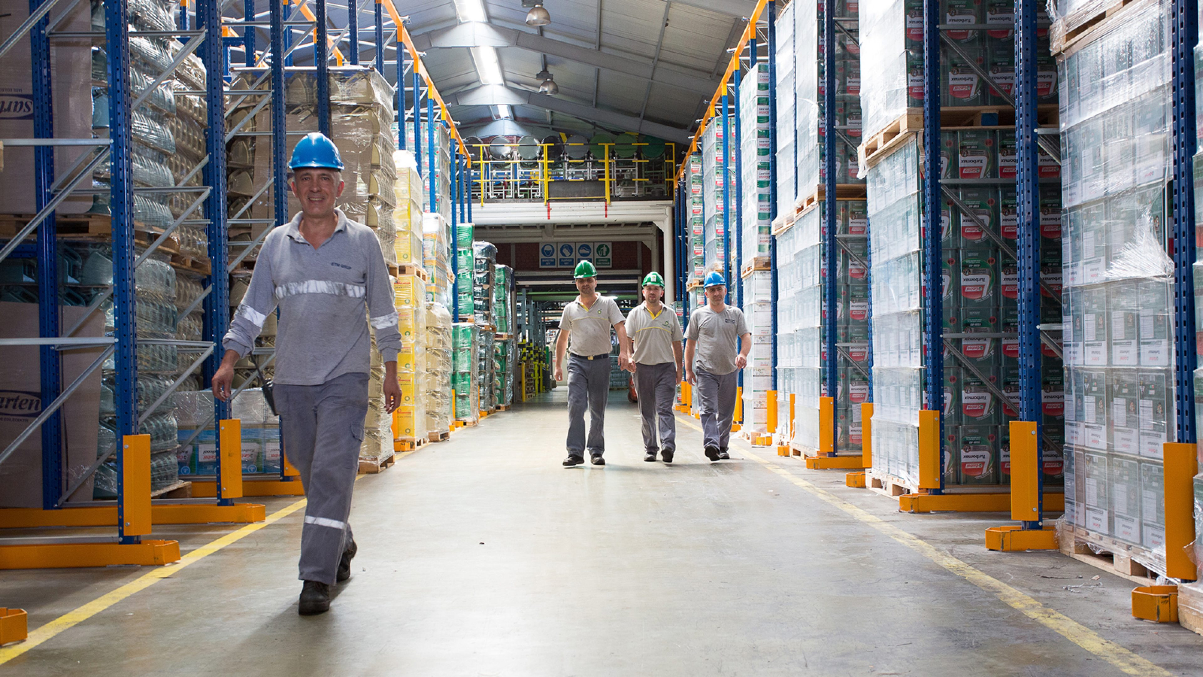 Workers walking through the packaging warehouse at the BP Gemlik Lubricants Plant, Turkey.