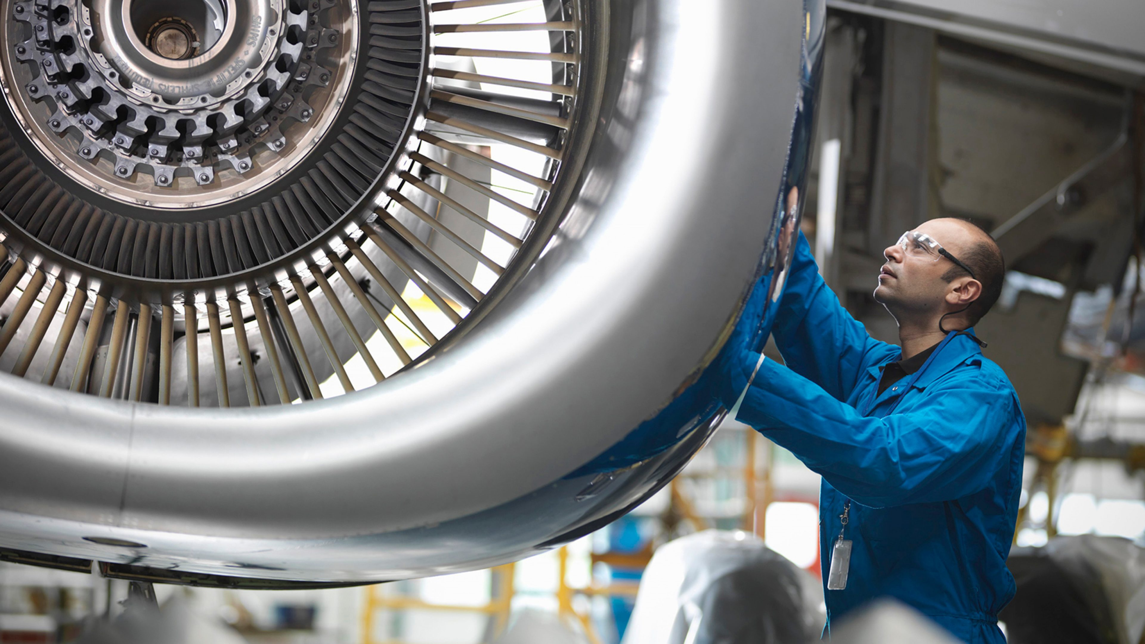 Engineer working on jet engine