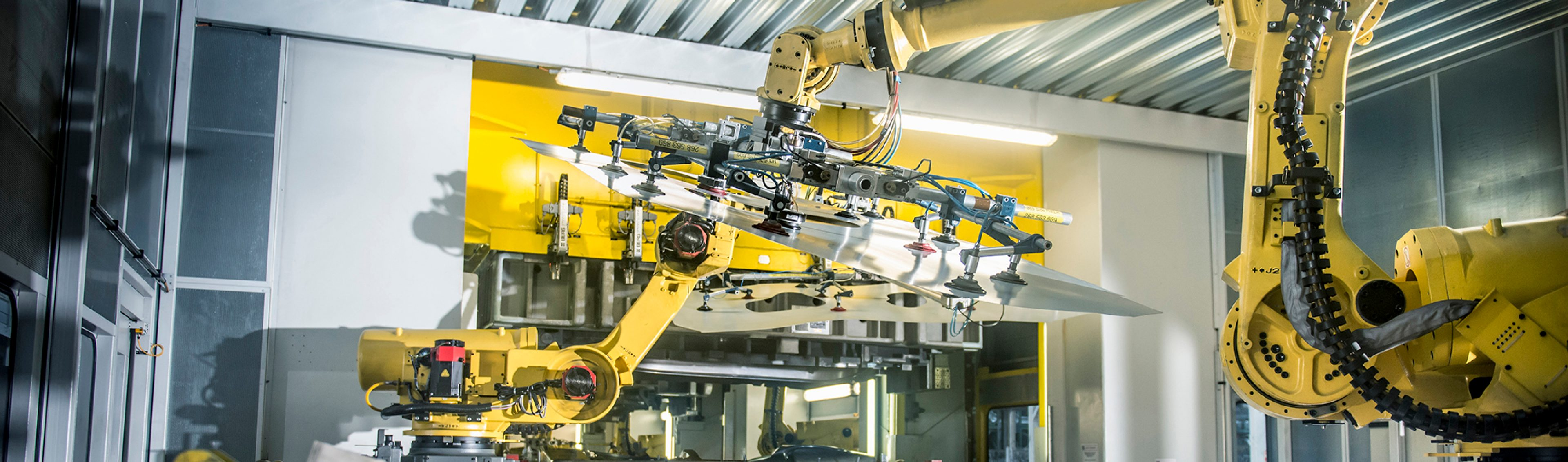 Car parts handled by robots in car factory --- Image by © Monty Rakusen/cultura/Corbis