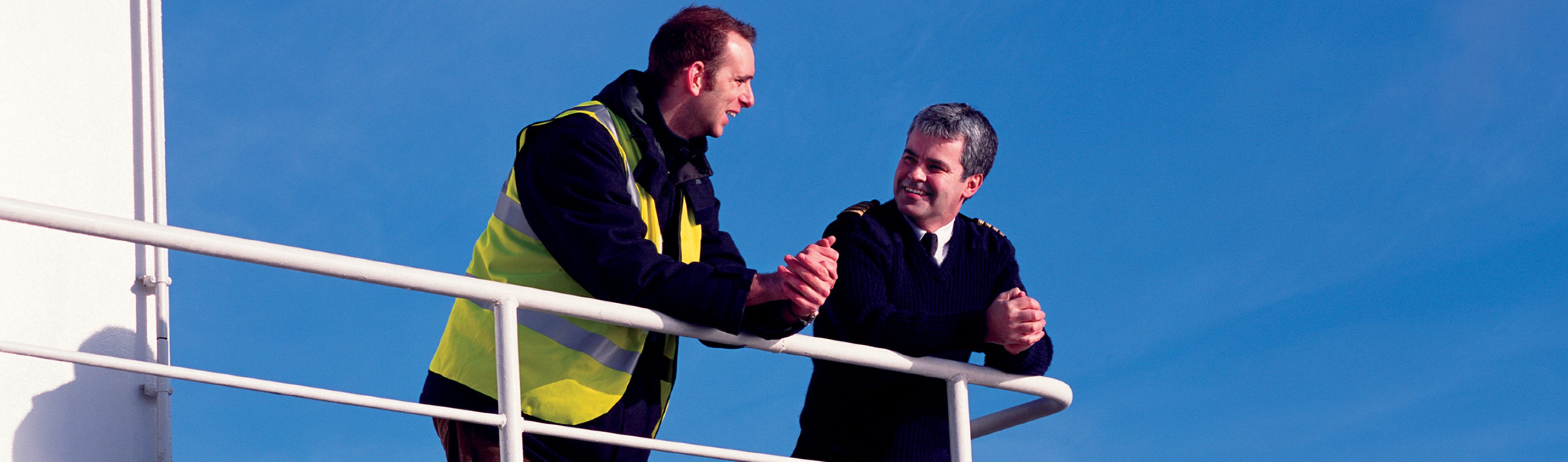 BP Marine Account Manager has a discussion with customer on board a vessel in London, UK.