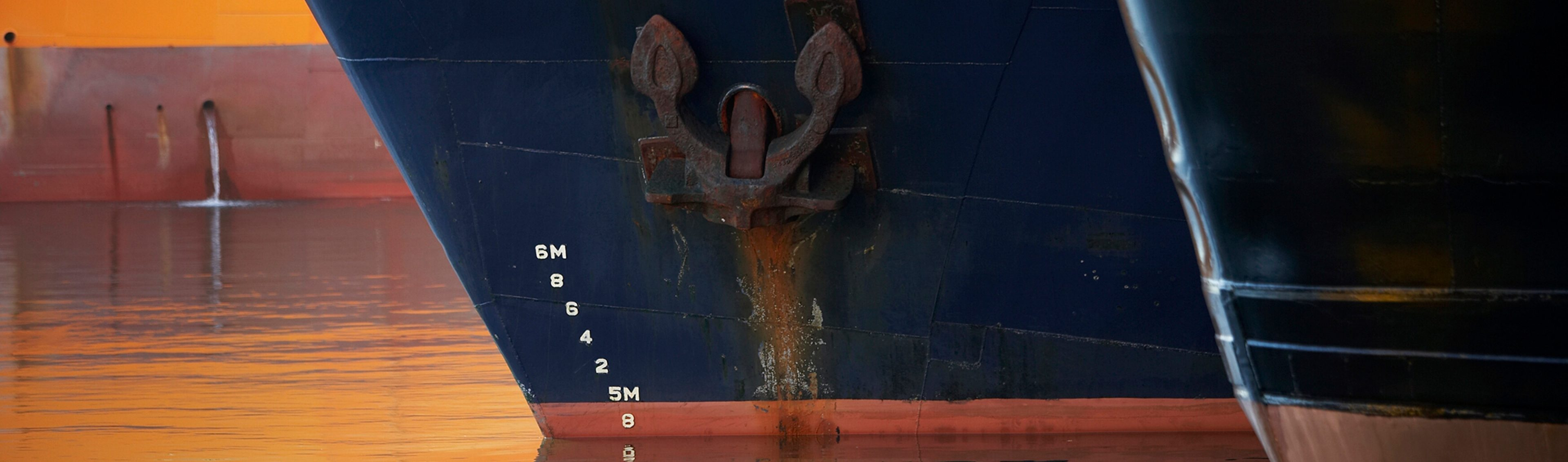 A supply vessel's bow and anchor at Aberdeen port, Scotland.