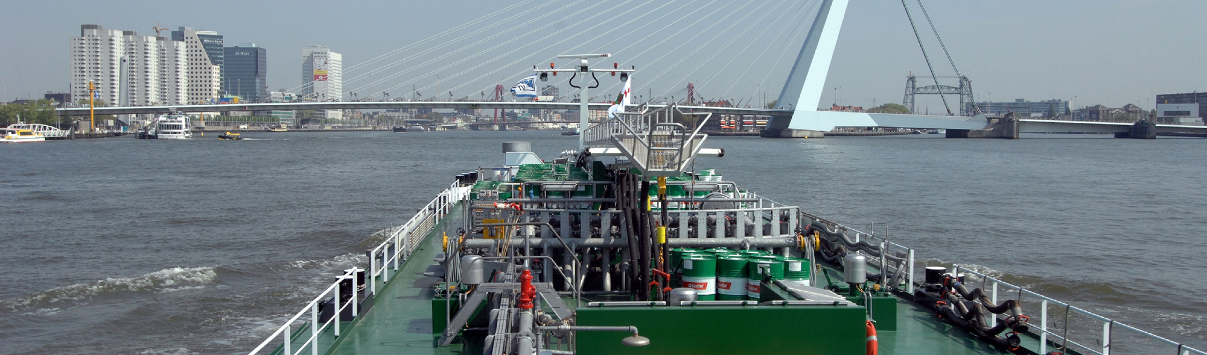 Large product barge m.t.'s Vanora passing through Rotterdam on the River Waal (Rhine) system delivering bulk marine lubricants to international shipping industry customers, Netherlands.