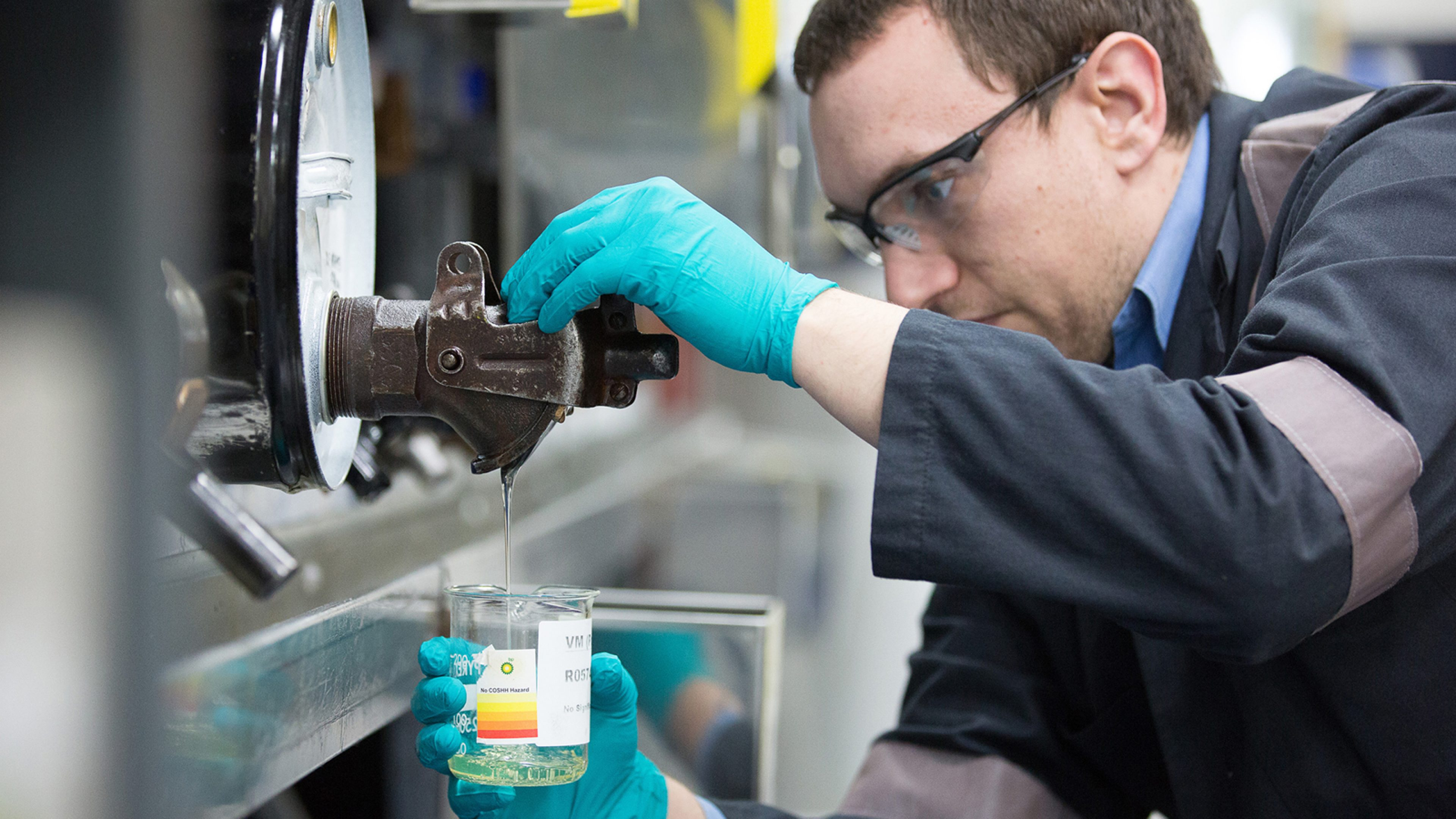 A technician dispenses a viscosity modifier into a beaker to add to a blend at the FPT Technology Center, Pangbourne UK.