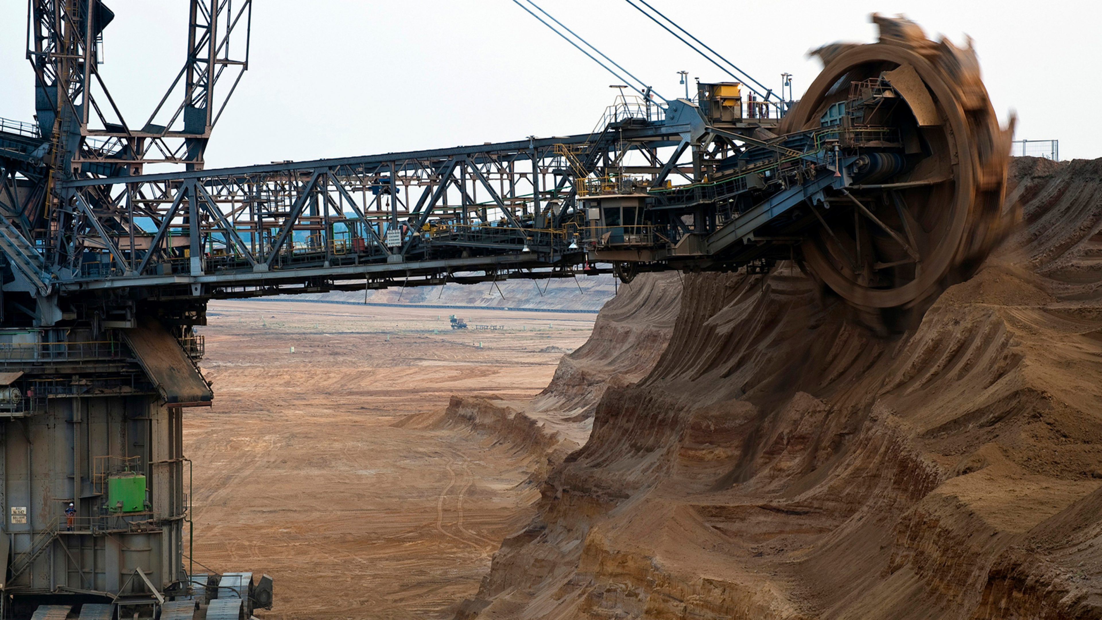 Bucket-wheel excavator on the slope of open pit