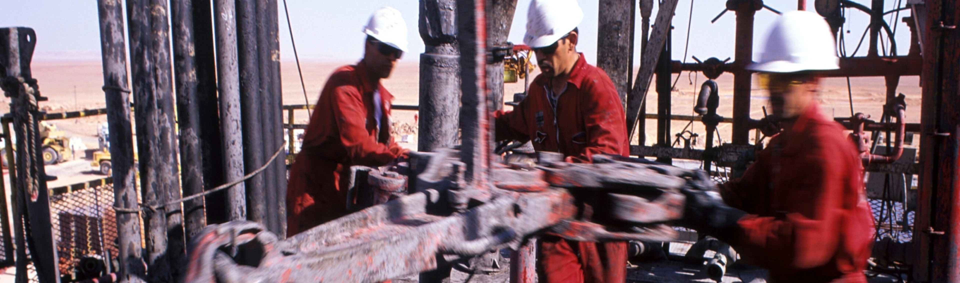 Operators working on the drill floor of Rig Teg 18 at the In Salah gas drill site in Algeria.