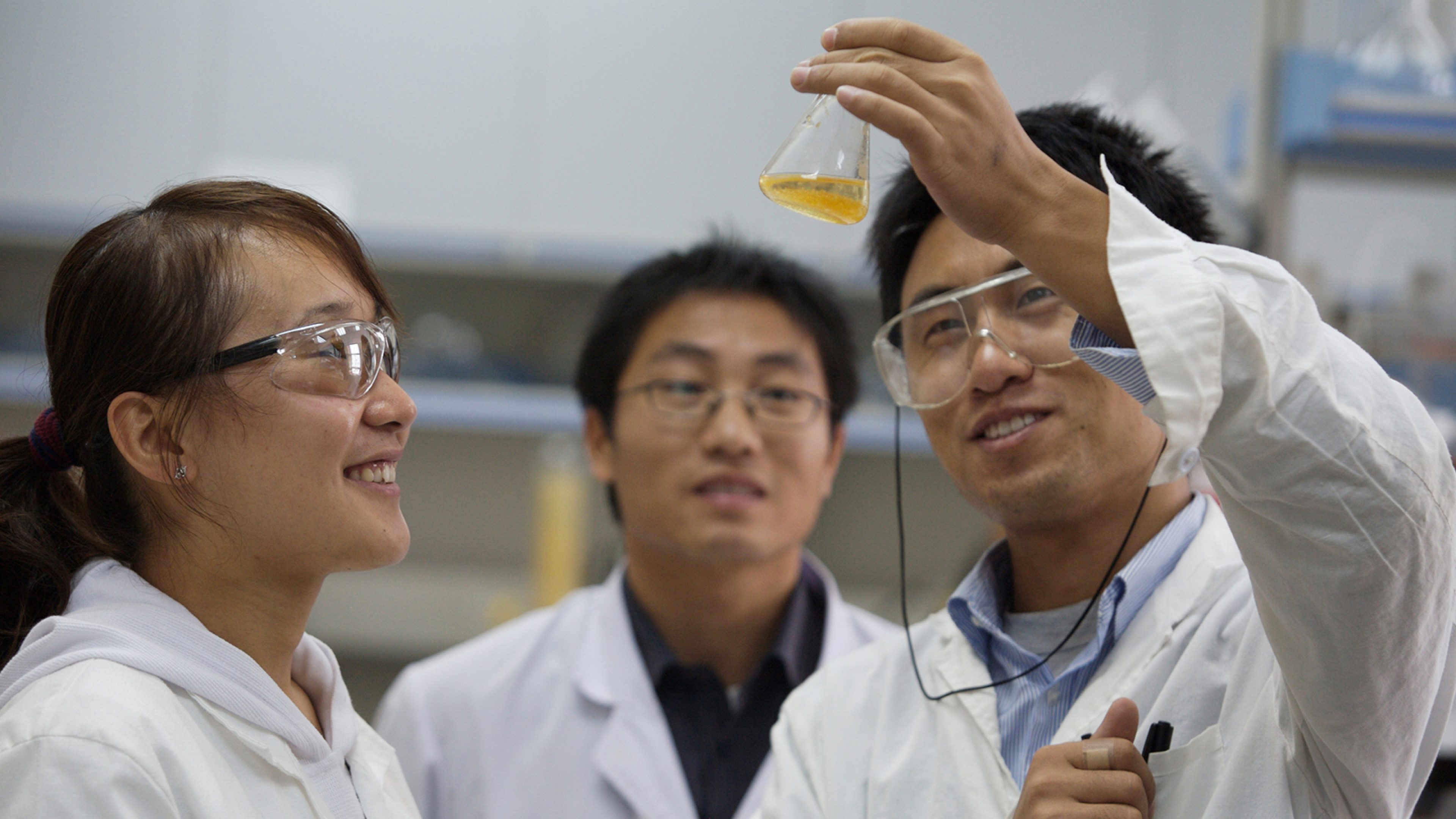 Researchers analyzing chemicals