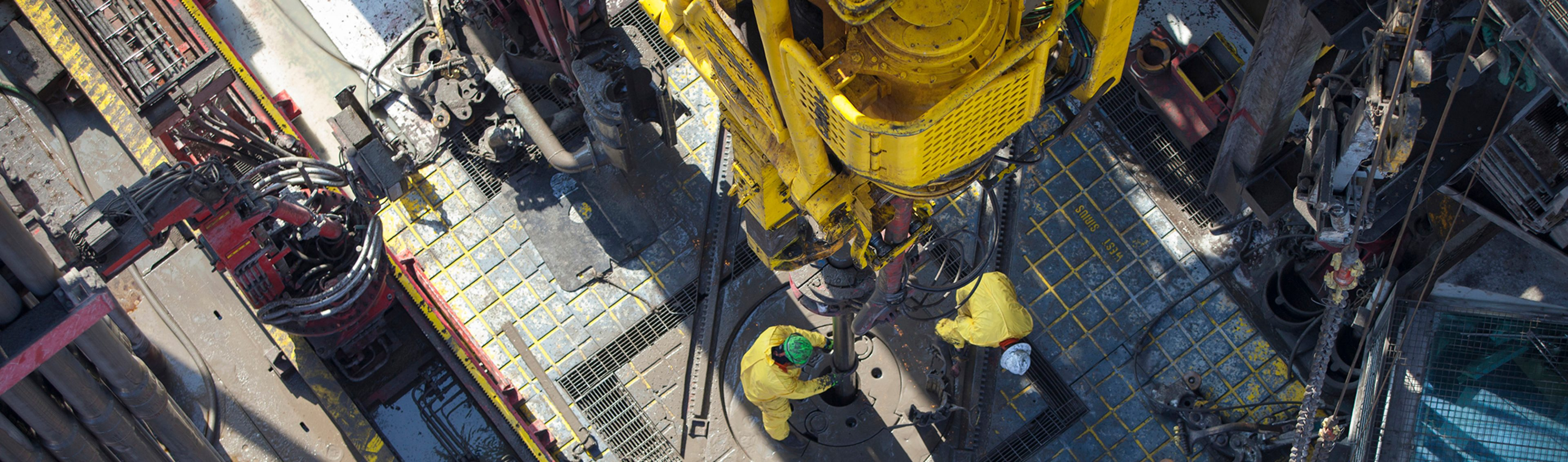 Birds eye view of drillers working on the rig floor as seen from the crown of the derrick, on Seadrill's West Sirius drilling rig in the Gulf of Mexico.
