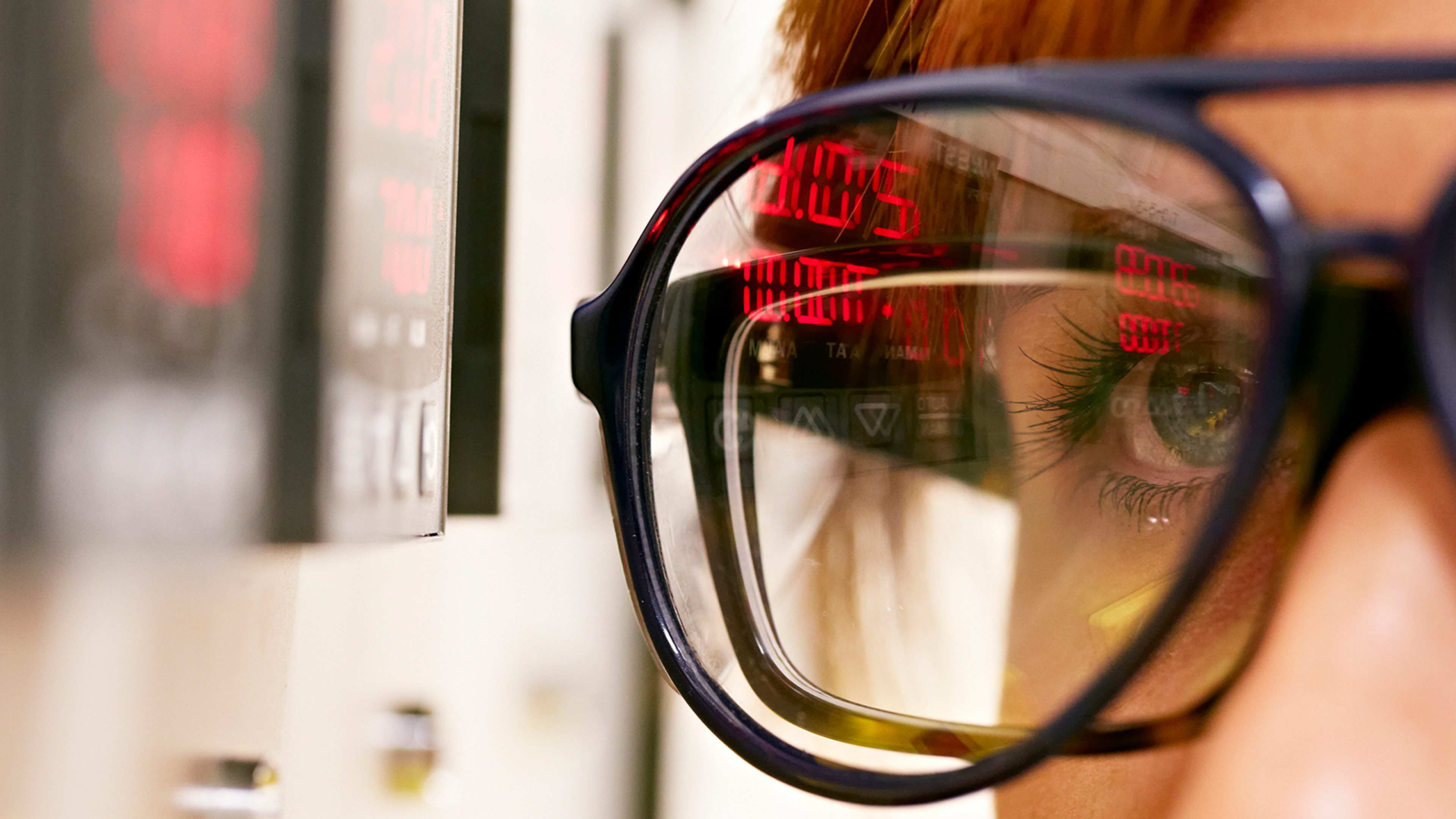 Digital readings reflected in glasses