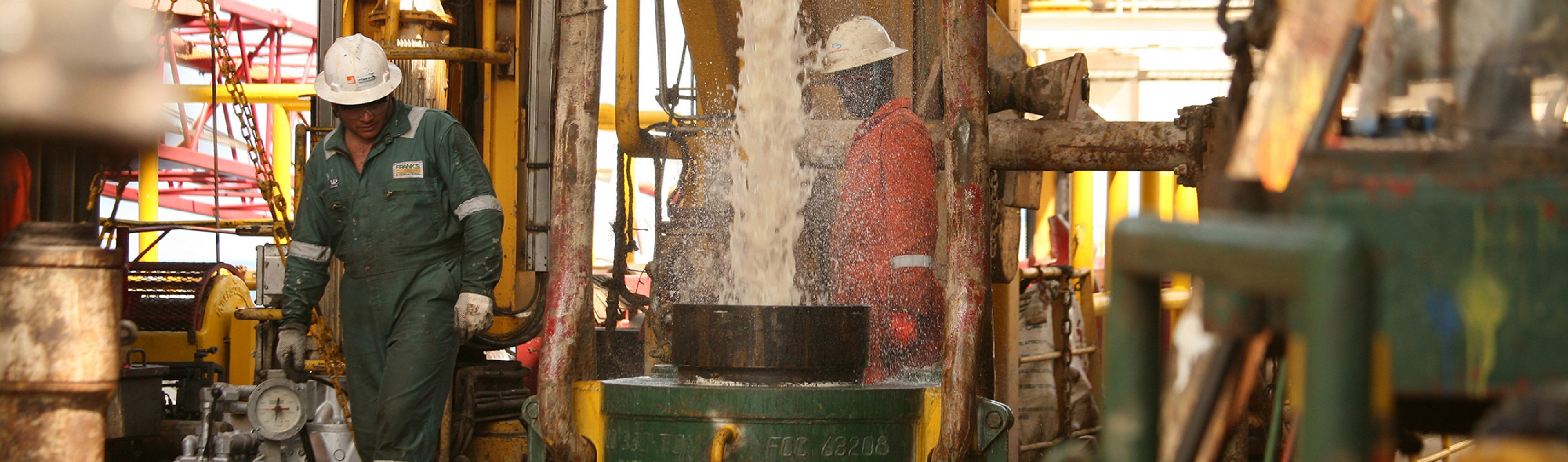 Technicians working on the drill floor of the Jack Ryan drilling ship, Block 31 in Angola.