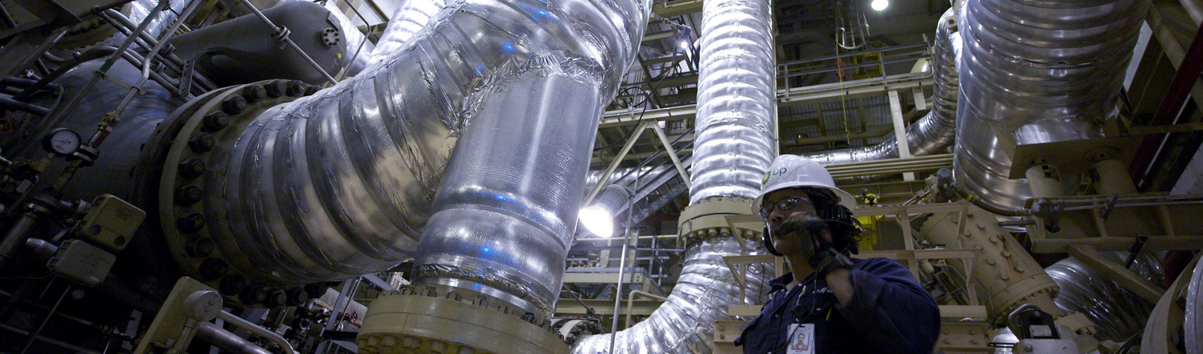 An operator at the Central Gas Facility Booster Compressor on the North Slope of Alaska, USA.