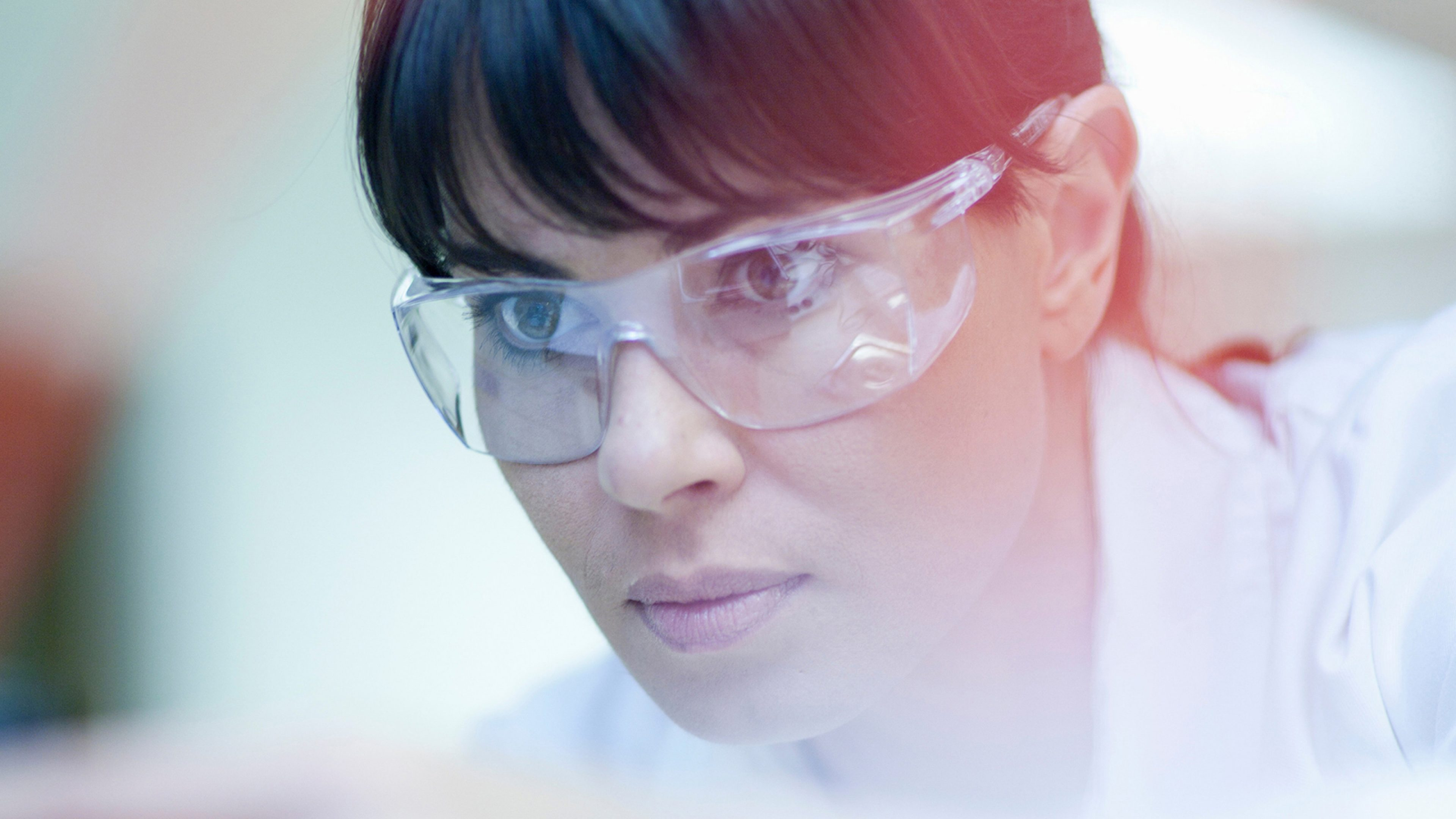 Woman working in laboratory --- Image by © Zero Creatives/Corbis