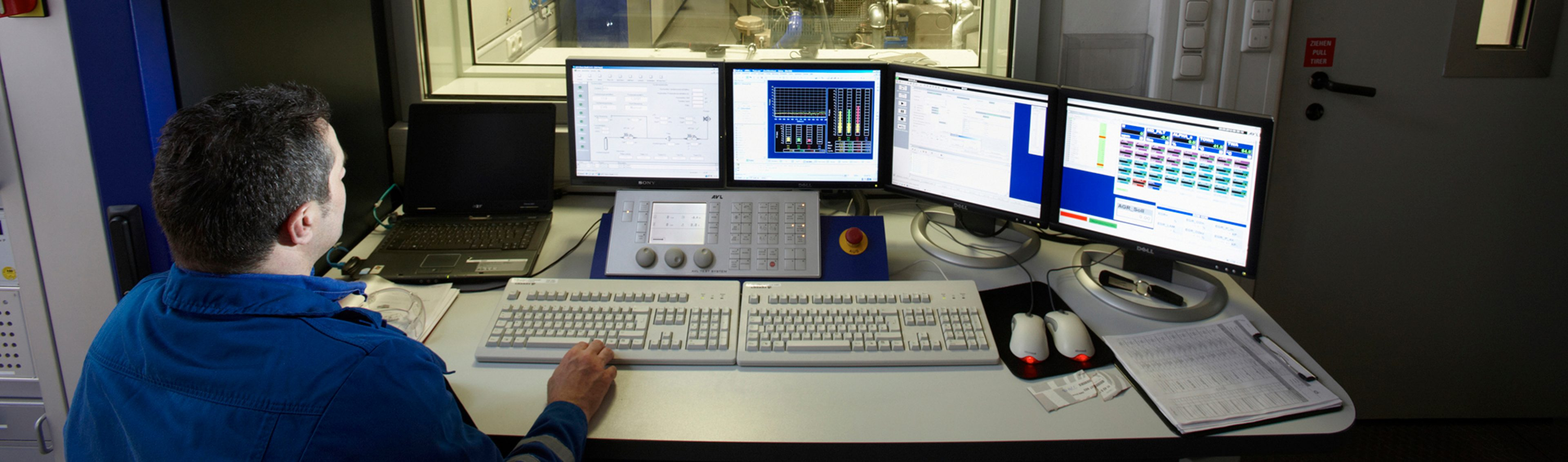 An operator monitors the engine test rig control unit's computer screens at the BP/Aral Fuel Research Centre Kraftstoffforschung, in Bochum, Germany.